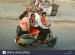 horizontal-aerial-view-of-an-entire-indian-family-on-one-tiny-moped-AD13MD.jpg